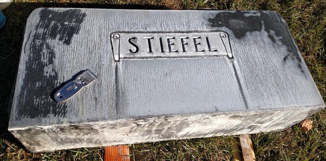 headstone before restoration